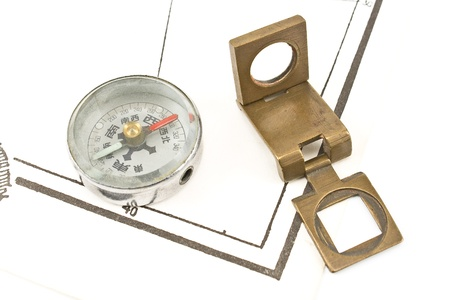 Antique compass and magnifying glass on map Stock Photo - 17696200