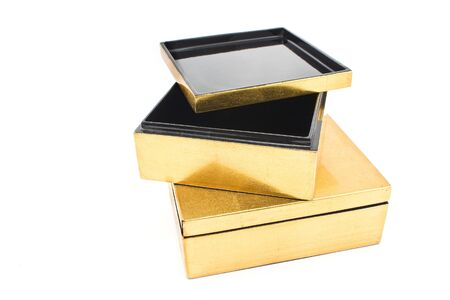 Two opened golden gift boxes isolated on  white