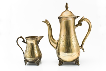 teakettle: Antique silver teapot and jug isolated on white