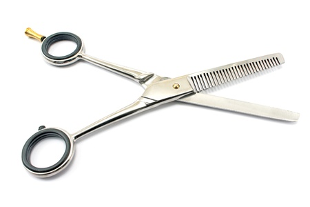 haircutting: Professional haircutting scissors isolated on white. Stock Photo