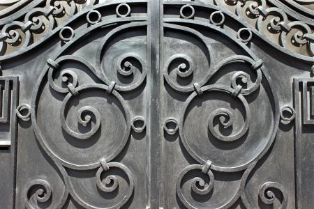 ironwork: Wrought iron hand made door as background Stock Photo
