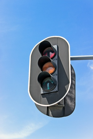 Traffic lights against sky background photo