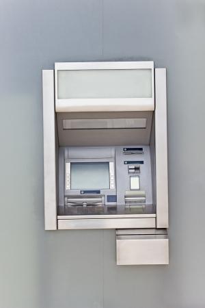 Cash dispense on metallic wall photo
