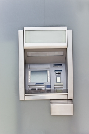 dispense: Cash dispense on metallic wall