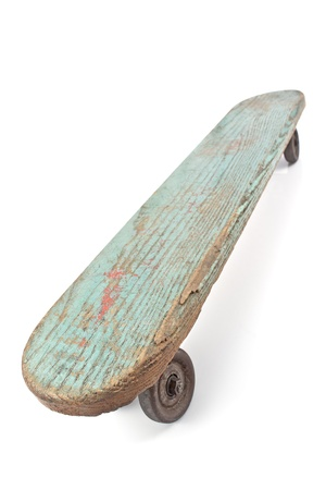 Old wooden skateboard isolated on white photo