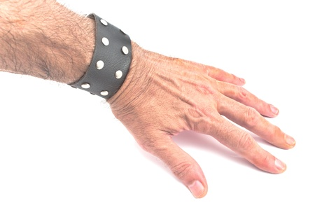 Hand with a black leather bracelet on white photo