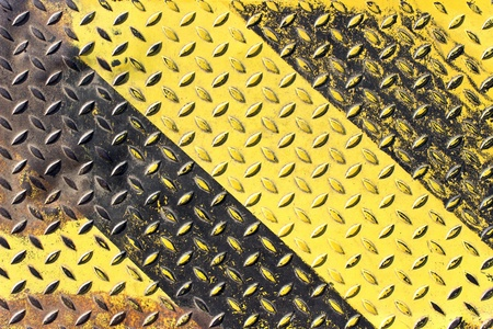 Grunge black and yellow iron surface background photo