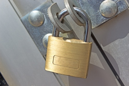 Closed padlock on a metal door photo