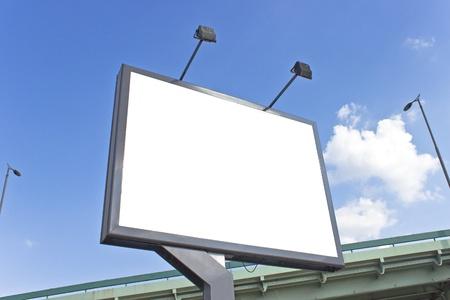 Billboard at highway over blue sky photo