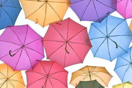 A lot of colorful umbrellas over sky photo