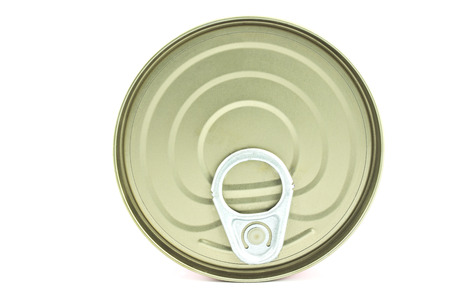 Food tin can lid isolated on white  photo