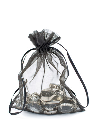 Black gift sack with diamonds isolated on white  photo