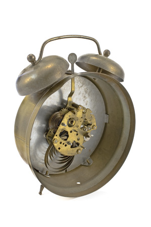 Inside mechanism of old alarm clock isolated on white photo