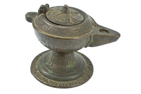 Antique bronze oil lamp isolated on white photo