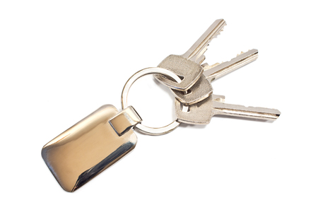 Keys with metal tag isolated on white photo