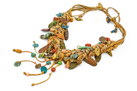 Necklace with ropes and ceramic isolated on withe photo