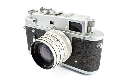 Vintage film photo camera isolated on white photo