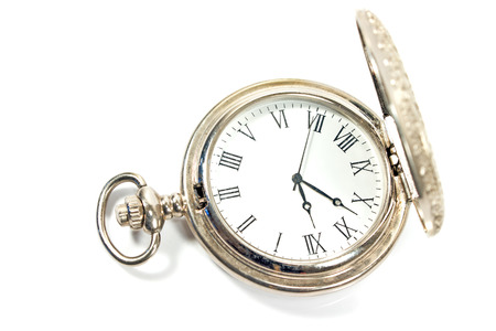 Silver pocket watch isolated on white photo