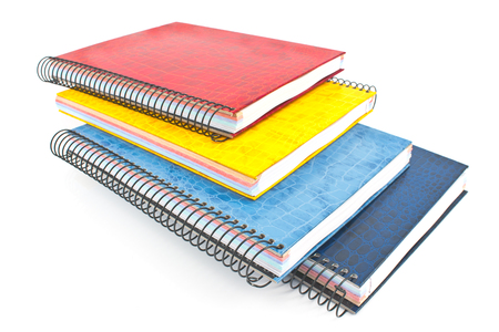 spiral binding: Stack of colorful spiral notebooks isolated on white