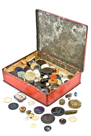 Clothing buttons collection in old tin box photo