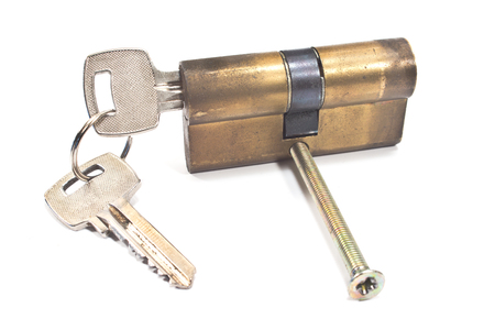 reliably: Old used brass cartridge cylinder with keys isolated on white