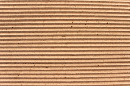 Texture of brown corrugate cardboard as background photo