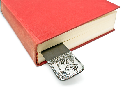 Bookmark in a book isolated on white photo