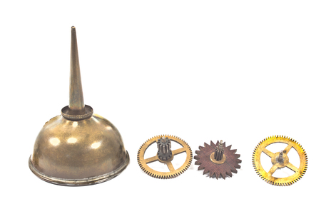 Vintage oil can dropper with cogwheels gears isolated on white  photo
