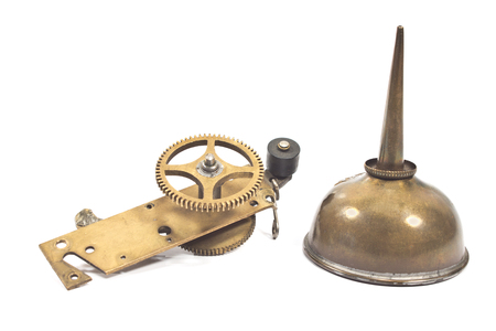 Vintage oil can dropper with cogwheel gear isolated on white  photo
