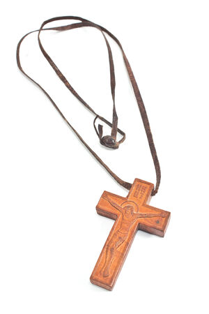 Wooden Christian cross necklace isolated on white photo