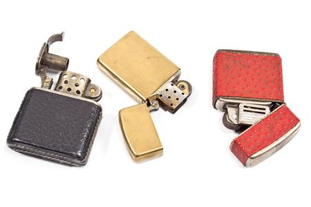 Three vintage lighter isolated on white photo