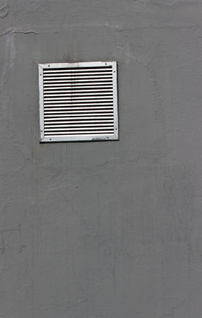 Vent window on gray  wall as background photo