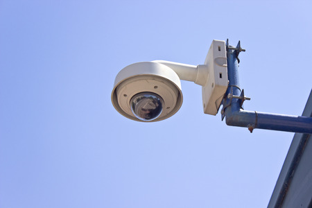 dome type: Hi-tech dome type surveillance camera over blue sky