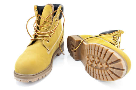 New yellow boots isolated on white photo