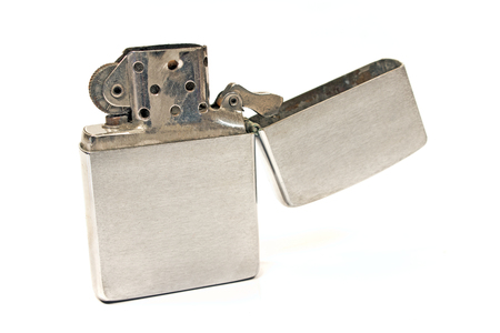 Silver vintage lighter isolated on white photo