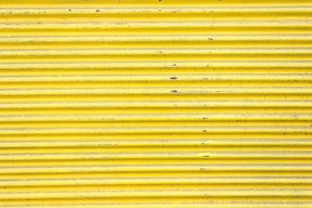Yellow corrugated metal sheet slide door as background photo