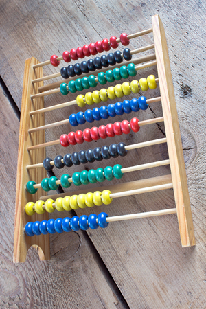 sums: Colorful Abacus on wooden background Stock Photo