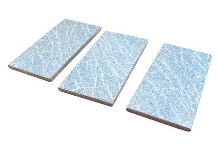 Blue ceramic tiles on white photo