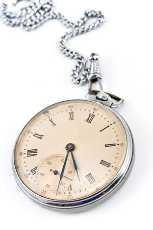 Old pocket watch with chain isolated on white  photo