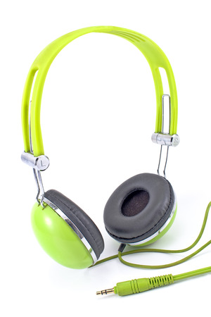 Green headphones isolated on white  photo
