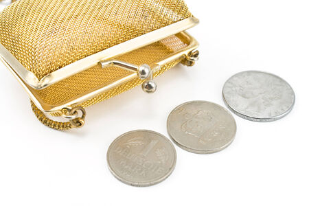 Golden purse with old european coins currency isolated on white photo