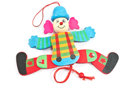 Mechanical clown toy on string  isolated on white photo