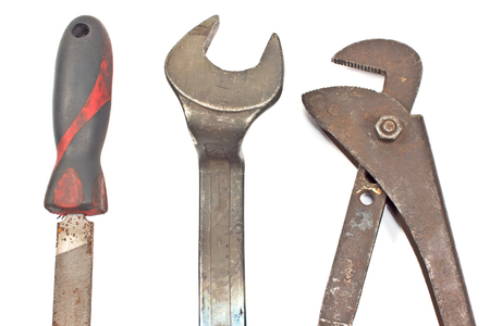 Set of old tools - rasp, spanner, wrench isolated on white  photo