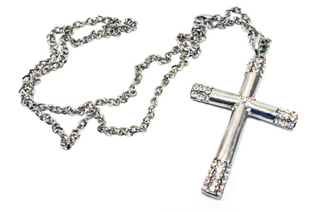 silver cross: Silver christian cross necklace isolated on white