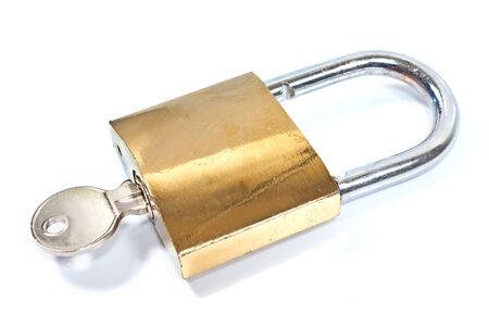 Padlock with key isolated on white photo
