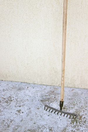 Rake tool over concrete background photo