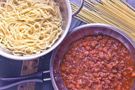 Spaghetti bolognese sauce in pan photo