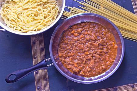 Spaghetti bolognese sauce in pan photo
