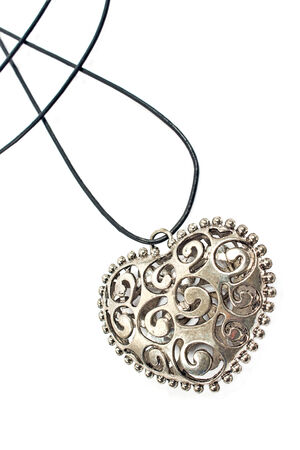 Silver heart pendant necklace on white Stock Photo