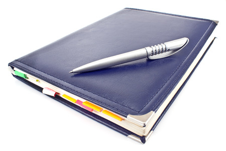 Pen and blue notebook isolated on white